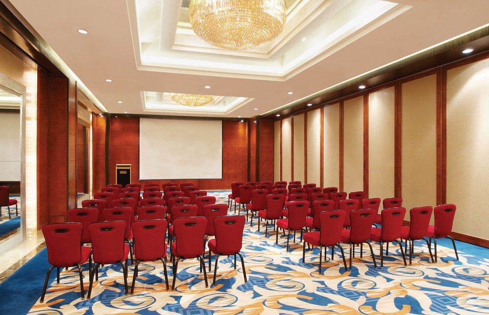 chair auditorium function hall conference hall red meeting convention center ballroom convention banquet empty set lined