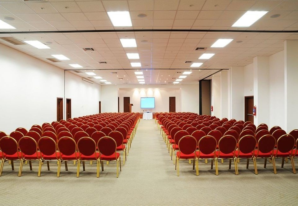 red auditorium chair conference hall function hall row convention center long meeting ballroom hall convention banquet lined line conference room