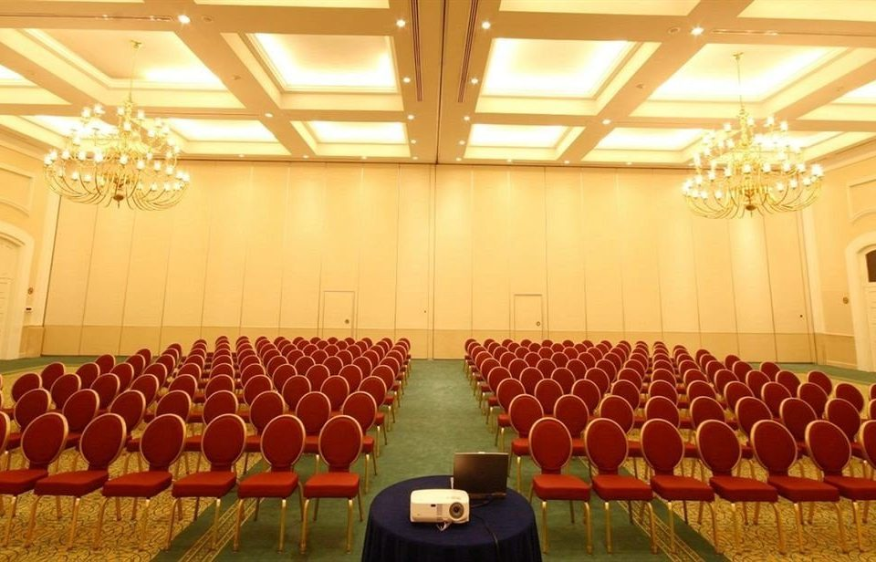 auditorium function hall conference hall convention center ballroom meeting banquet convention orange colored