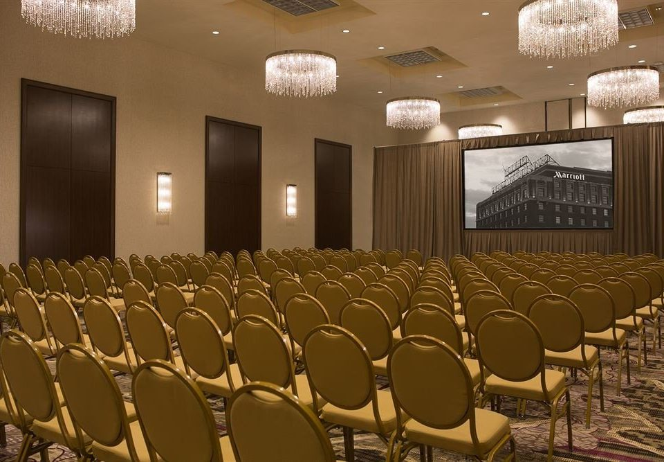 auditorium function hall conference hall ballroom row convention center stage theatre banquet convention lined line colored