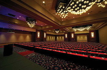 auditorium building performing arts center function hall stage performing arts red theatre convention center movie theater ballroom long musical theatre conference hall hall night walkway