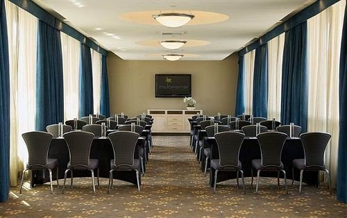 chair conference hall function hall auditorium meeting convention center ballroom restaurant conference room dining table