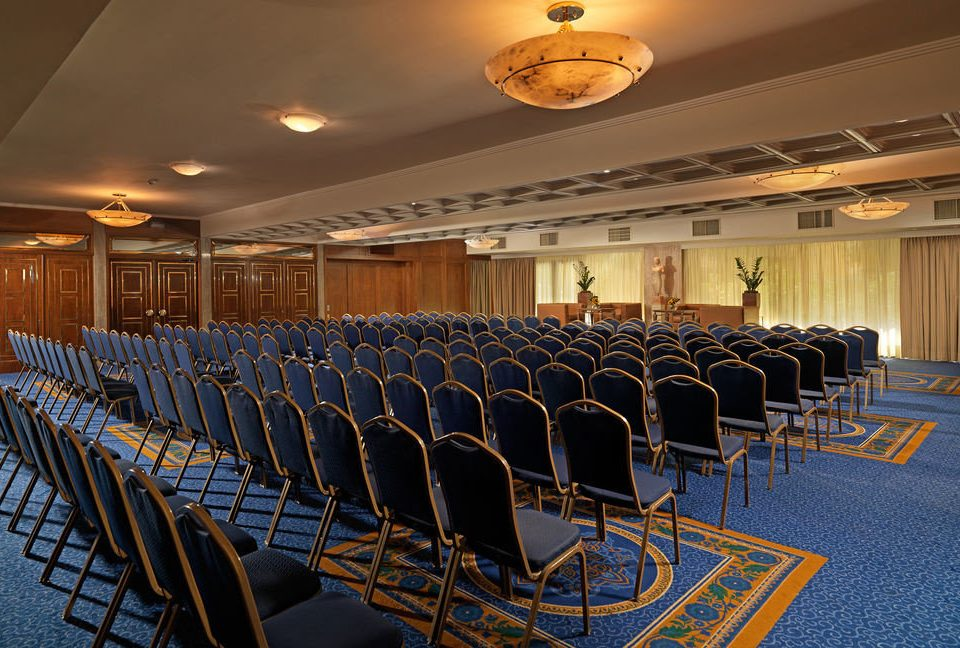 chair auditorium conference hall function hall convention center ballroom theatre convention meeting lined line