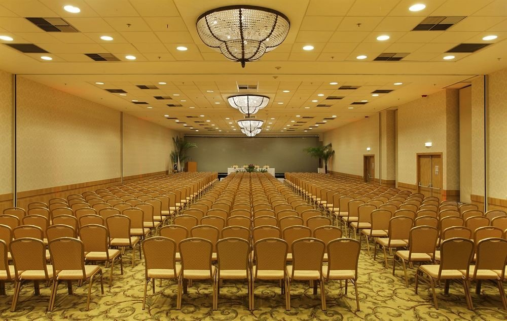 chair auditorium function hall conference hall performing arts center convention center ballroom row meeting hall set lined surrounded line