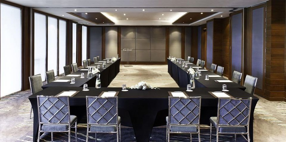 chair conference hall function hall auditorium convention center meeting ballroom dining table