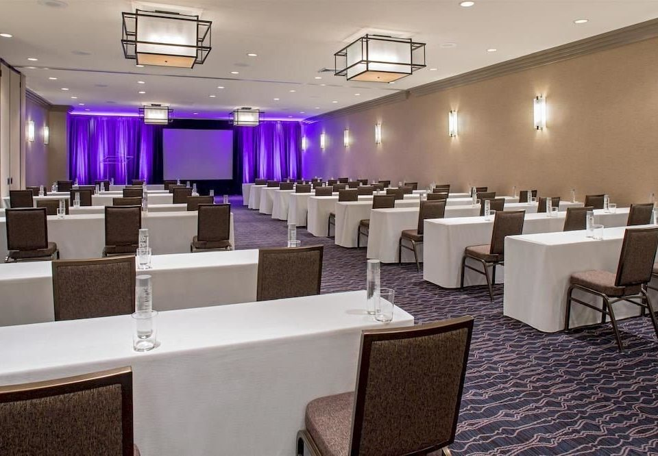 chair conference hall function hall auditorium convention center restaurant purple meeting ballroom conference room