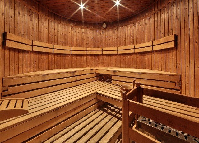 wooden bench man made object auditorium sauna bathroom