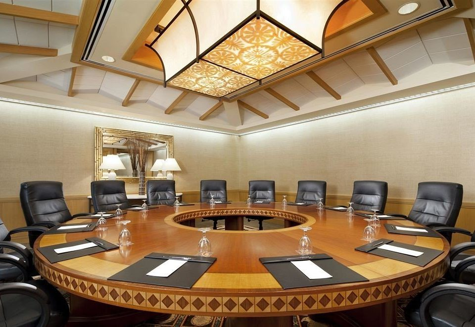 desk conference hall building function hall billiard room recreation room convention center auditorium office conference room cluttered dining table