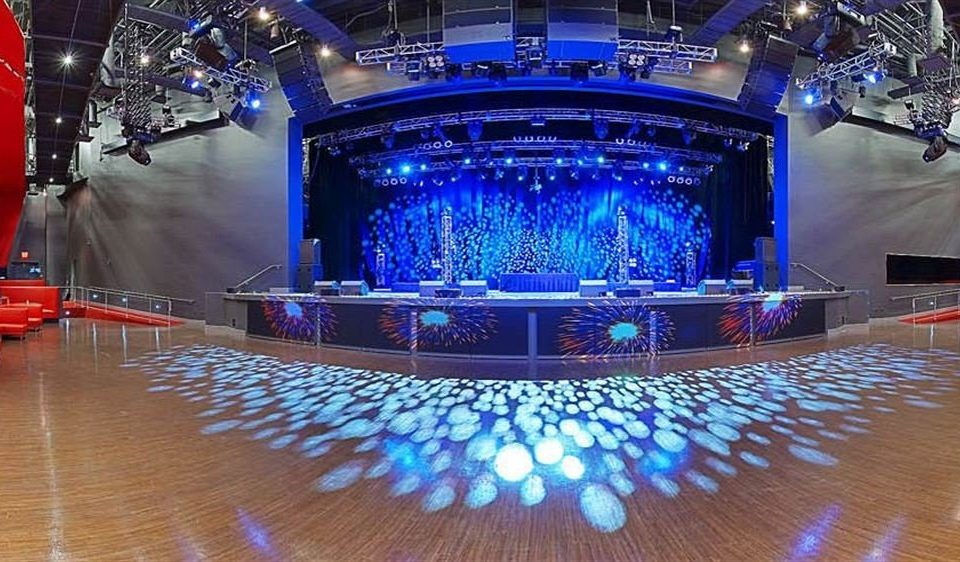 stage auditorium performing arts scene nightclub theatre musical theatre music venue display device disco scenographer blue