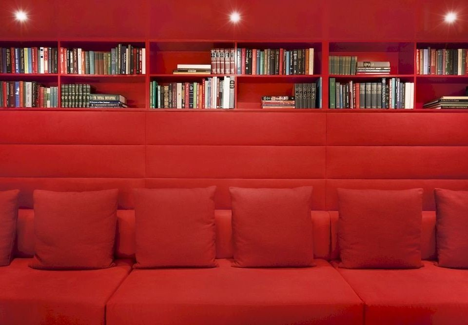 shelf book sofa red library seat movie theater auditorium living room orange