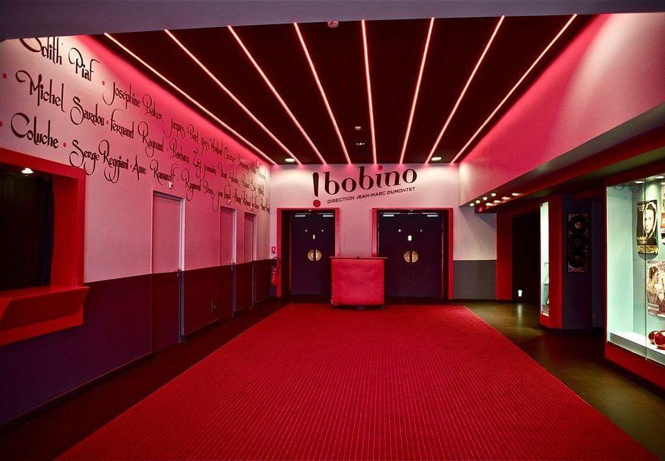 red auditorium stage function hall movie theater theatre brand convention center nightclub