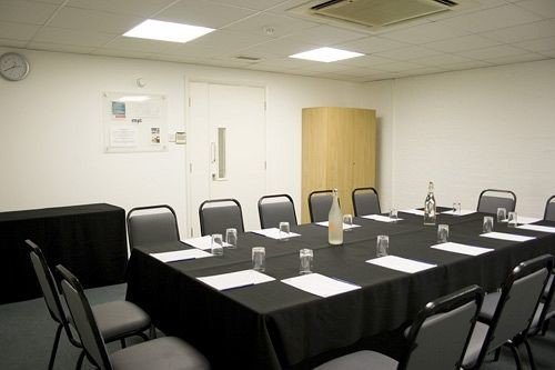 chair conference hall meeting conference room function hall seminar auditorium classroom restaurant