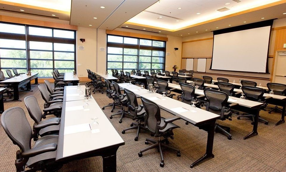 classroom chair conference hall auditorium meeting convention center conference room