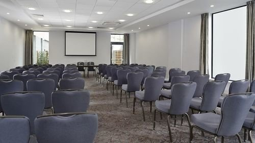 chair auditorium conference hall scene meeting convention center conference room lined