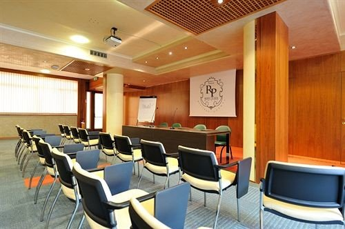 chair conference hall auditorium function hall convention center meeting recreation room conference room