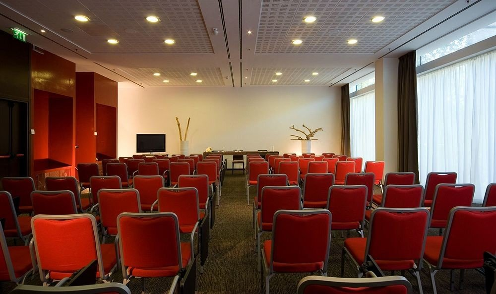 chair auditorium conference hall red function hall convention center meeting orange convention set conference room