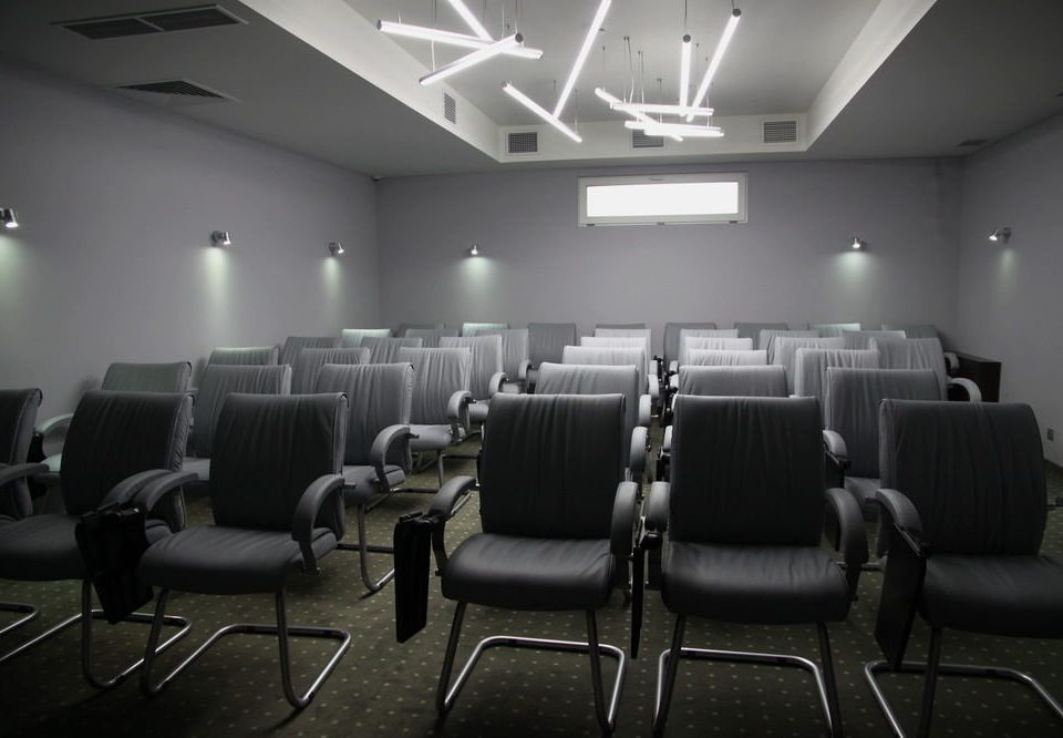 auditorium chair conference hall convention center waiting room theatre movie theater conference room