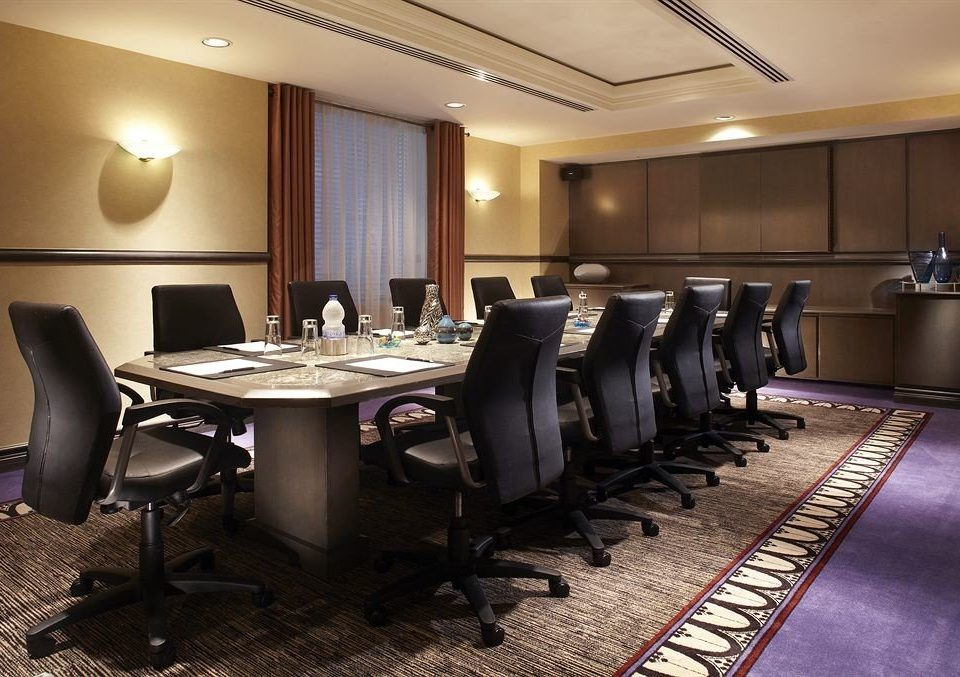 chair conference hall desk auditorium recreation room function hall convention center office