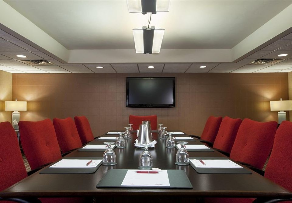 red conference hall function hall recreation room meeting auditorium conference room