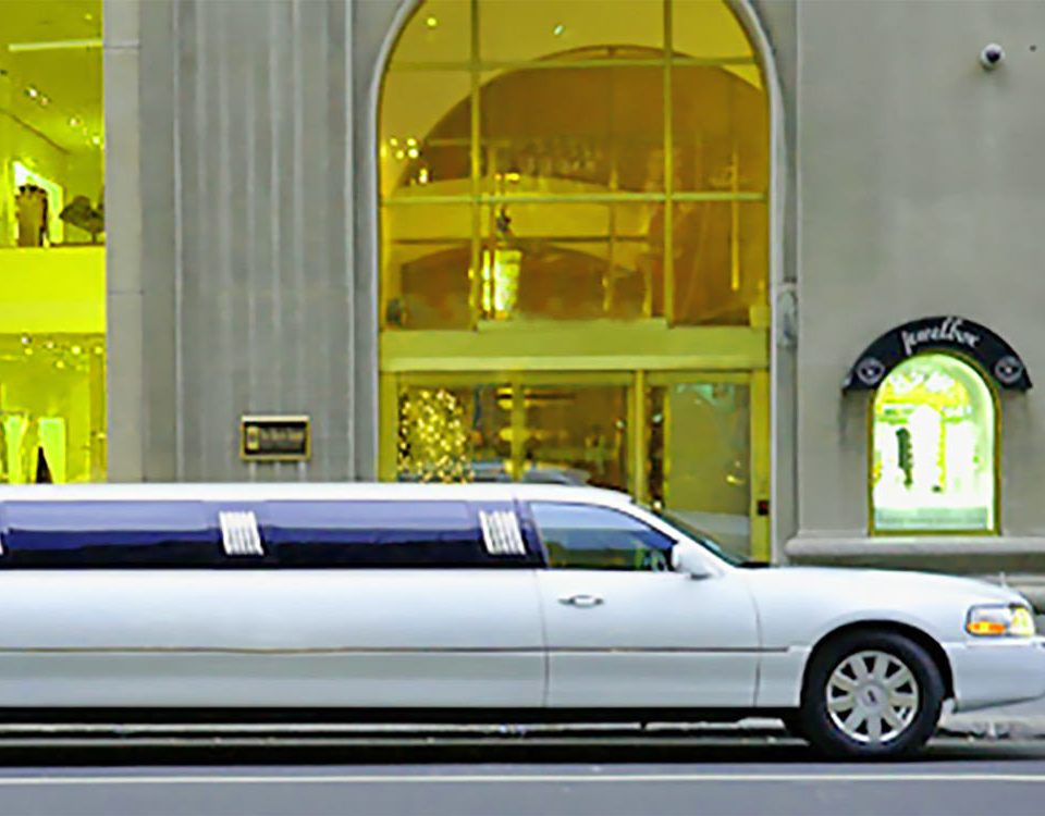 car limousine luxury vehicle vehicle land vehicle transport automotive exterior automobile make parked public transport sedan