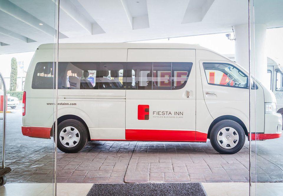 vehicle car land vehicle transport bus minibus van commercial vehicle automobile make parked tour bus service public transport recreational vehicle toyota