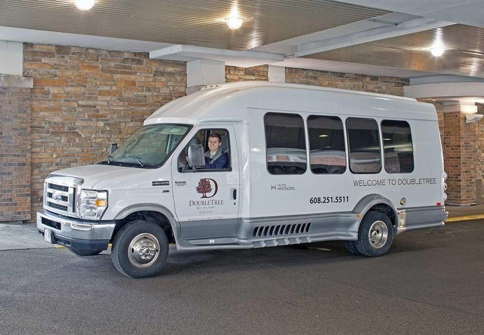 road vehicle car land vehicle transport recreational vehicle commercial vehicle automobile make van white public transport minibus bus roof