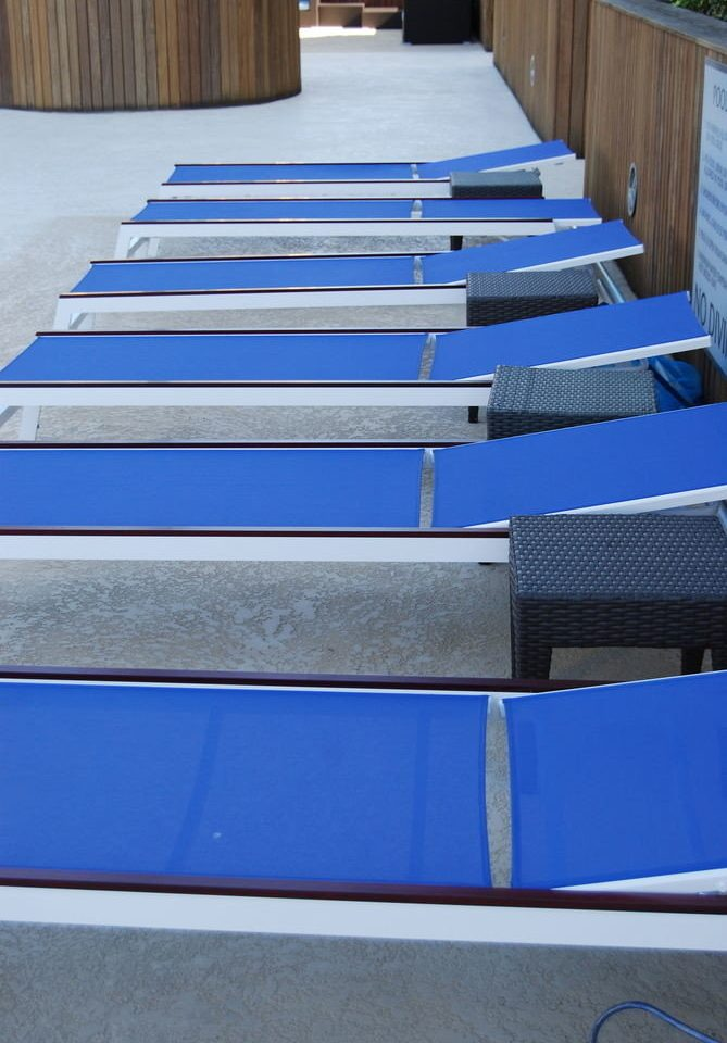 blue structure automotive exterior sport venue flooring roof swimming pool bench seat