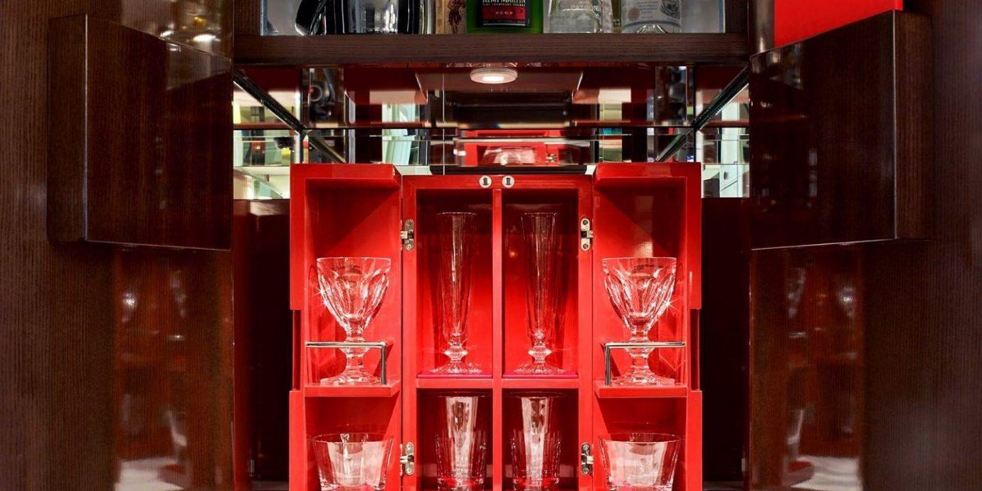 Hotels indoor red shelf room furniture cabinetry interior design