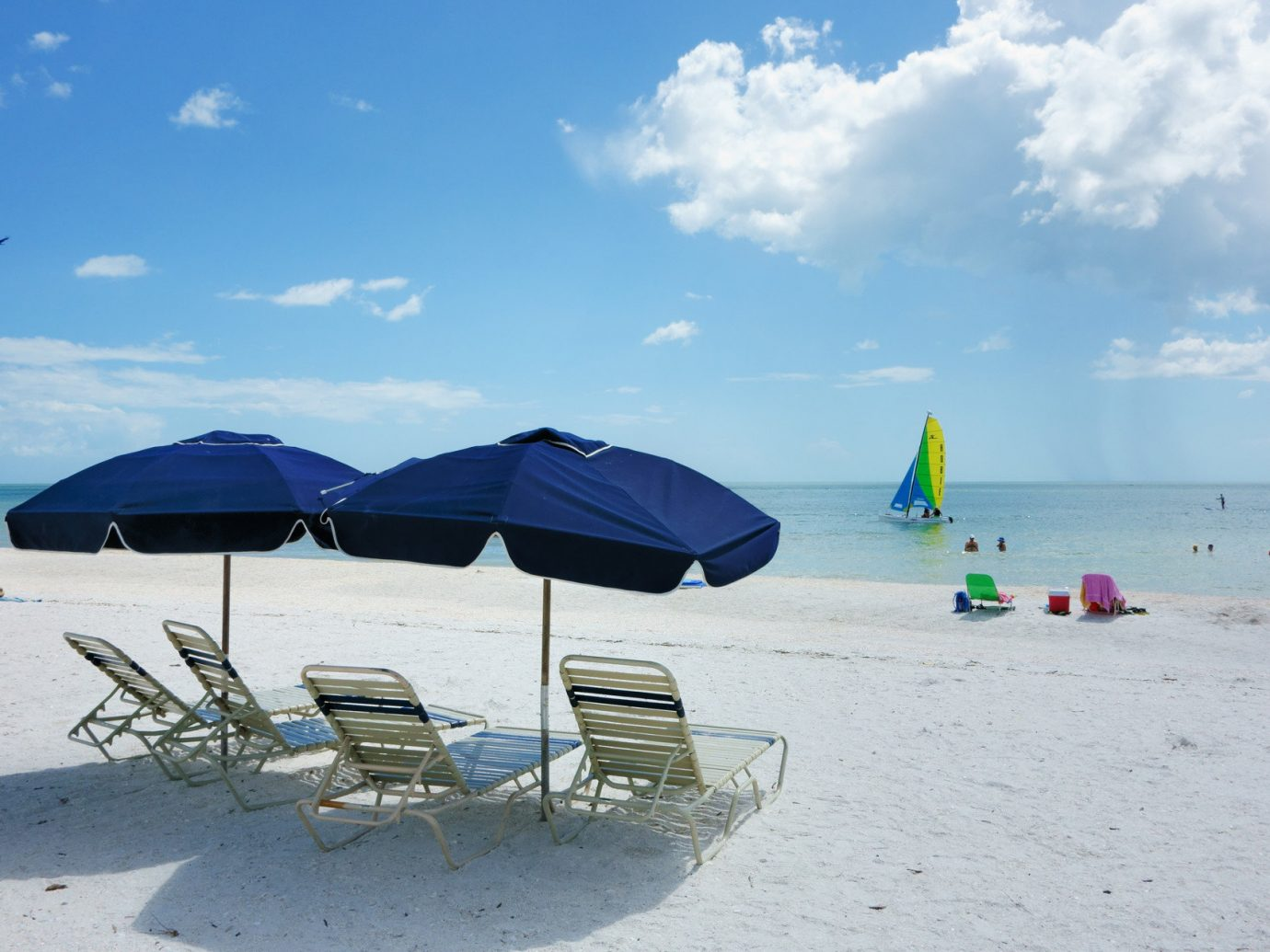 Trip Ideas sky outdoor Beach umbrella body of water Sea Ocean Nature shore vacation Coast bay sand wind day sandy several