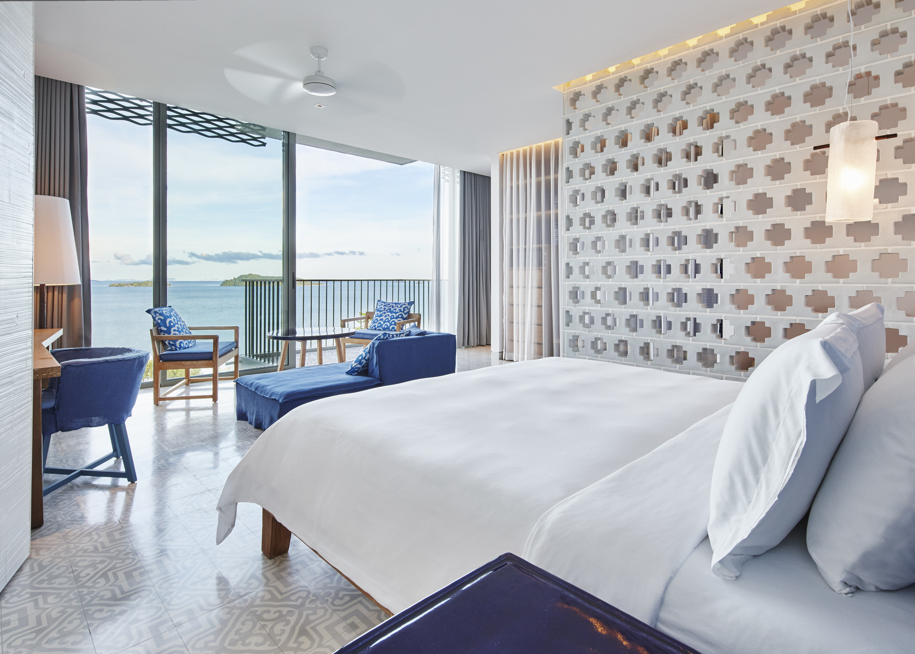 Beach Hotels Phuket Thailand indoor floor bed room Suite window hotel wall interior design real estate Bedroom penthouse apartment apartment estate comfort ceiling interior designer bed frame boutique hotel furniture
