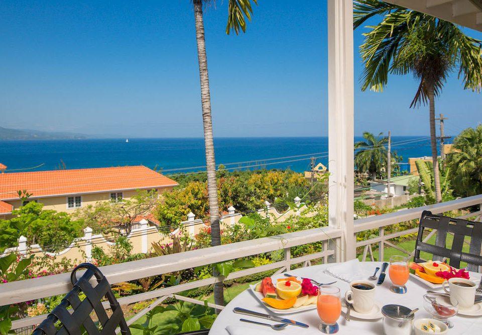 B&B Balcony Beach Budget Sea sky leisure chair Resort caribbean arecales Villa palm overlooking porch colorful Deck shore