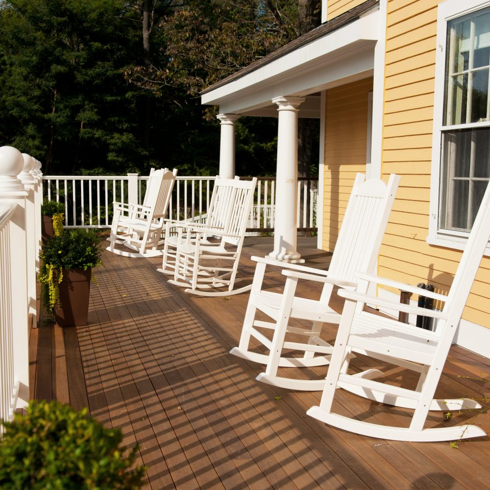 B&B Balcony Deck Inn Romantic Waterfront tree building porch property home backyard outdoor structure white cottage Patio Garden stone