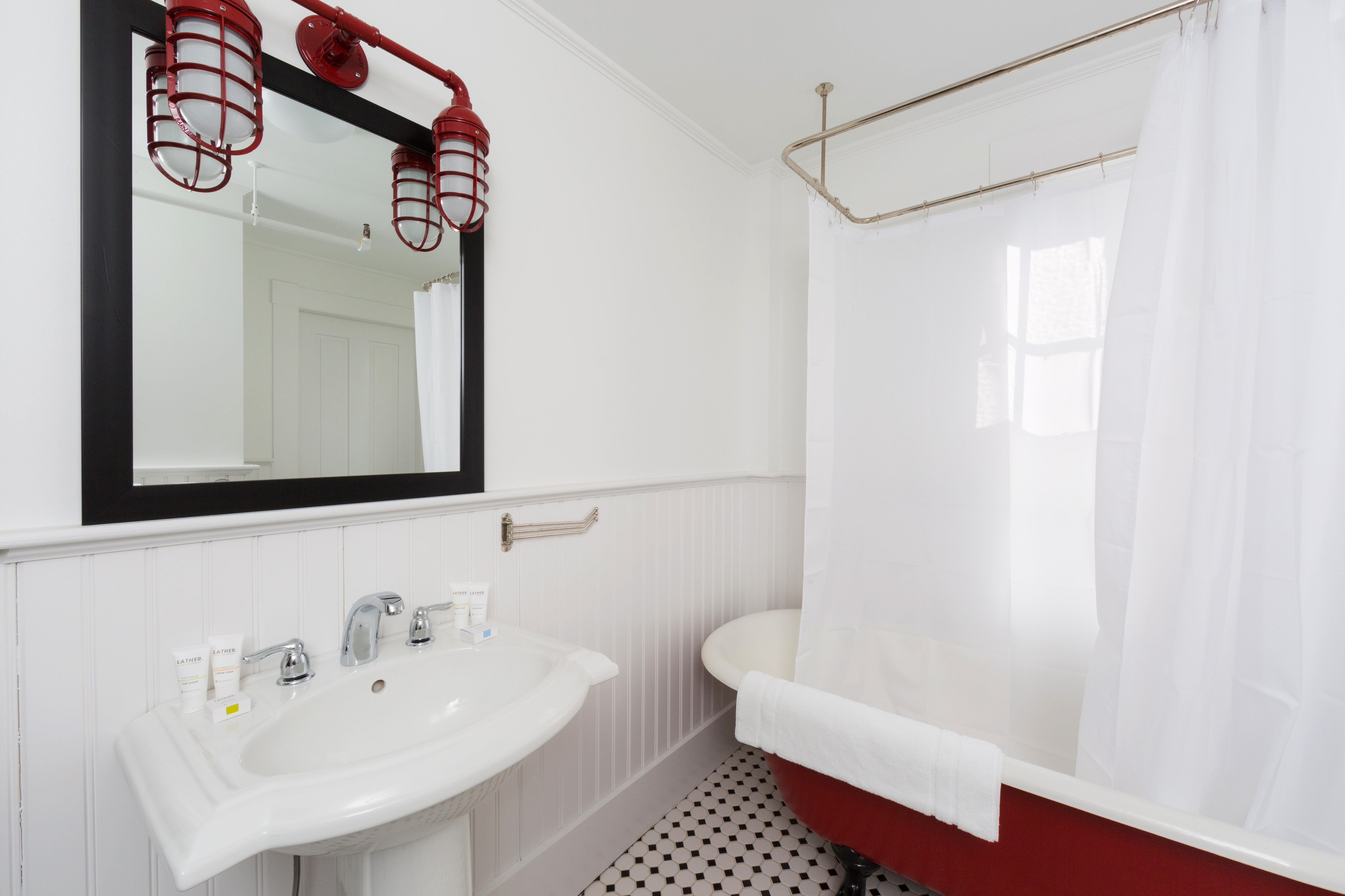 B&B Bath Boutique Budget bathroom property toilet white sink home cottage tile tub bathtub tiled