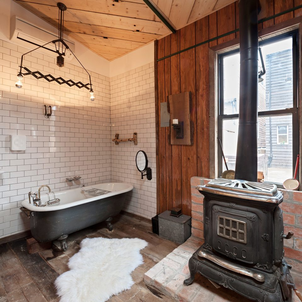 B&B Bath Fireplace Hip Rustic bathroom property home cottage hardwood farmhouse Kitchen old stone tub dirty tiled