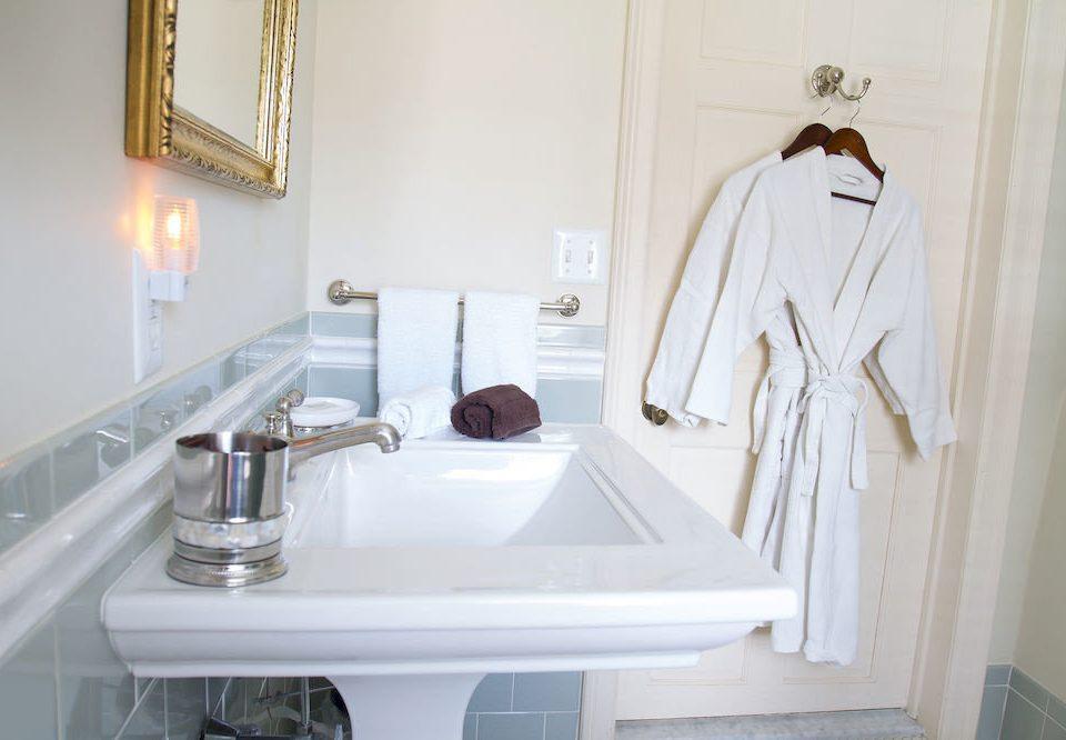 B&B Bath Inn bathroom sink plumbing fixture home toilet bathtub flooring tub