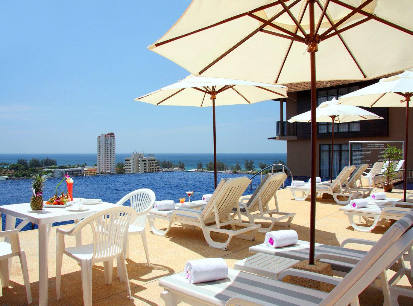 B&B Beachfront Deck Pool Scenic views sky chair restaurant Resort Villa cottage set day