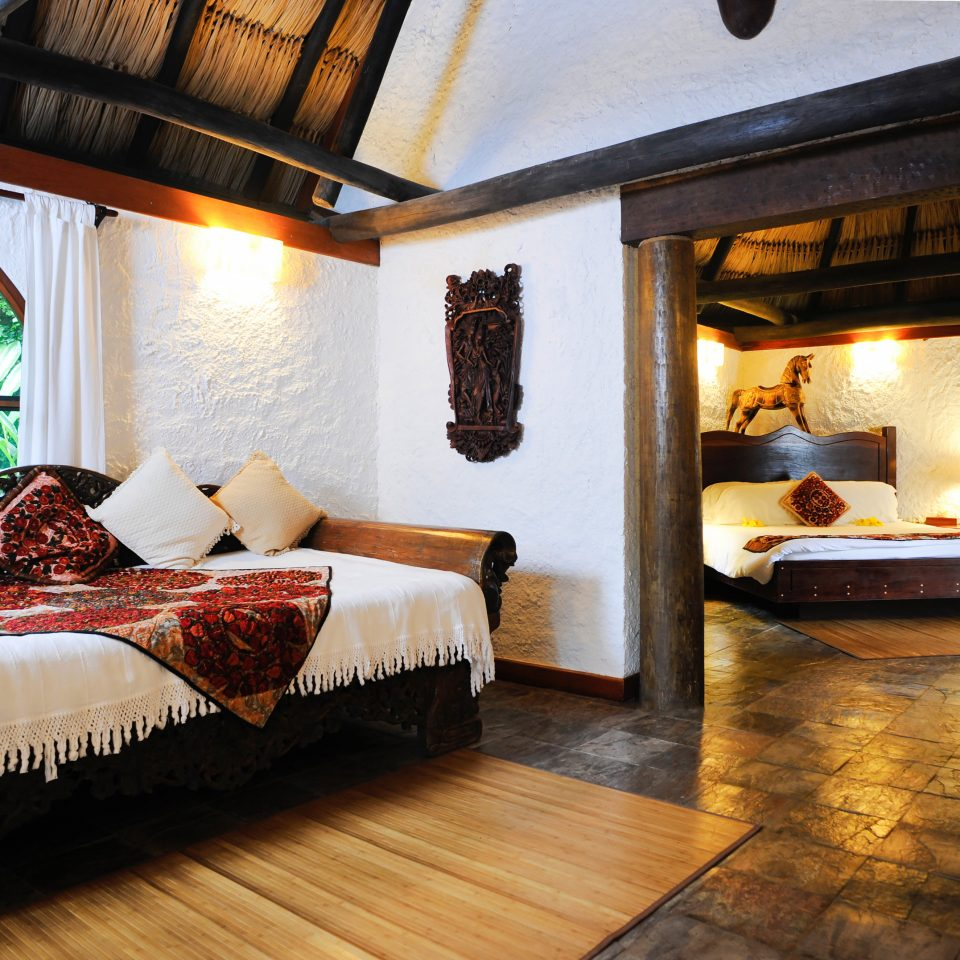 B&B Bedroom Eco Lodge Romantic Tropical property building house living room home Villa Resort cottage Fireplace Suite mansion farmhouse hacienda