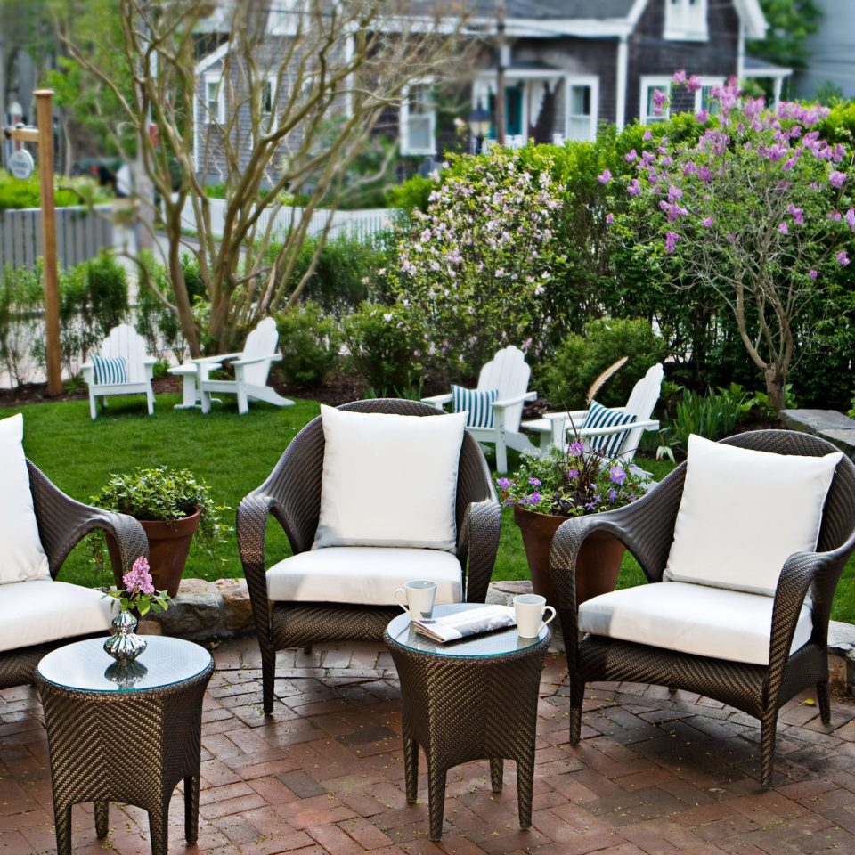 B&B Boutique Grounds Inn Patio tree chair backyard yard Garden Courtyard outdoor structure home flower porch cottage lawn set arranged