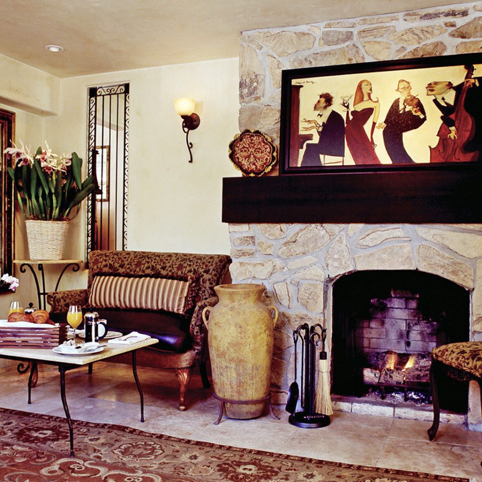 B&B Boutique Drink Eat Fireplace Historic Inn living room property fire home hearth cottage stone