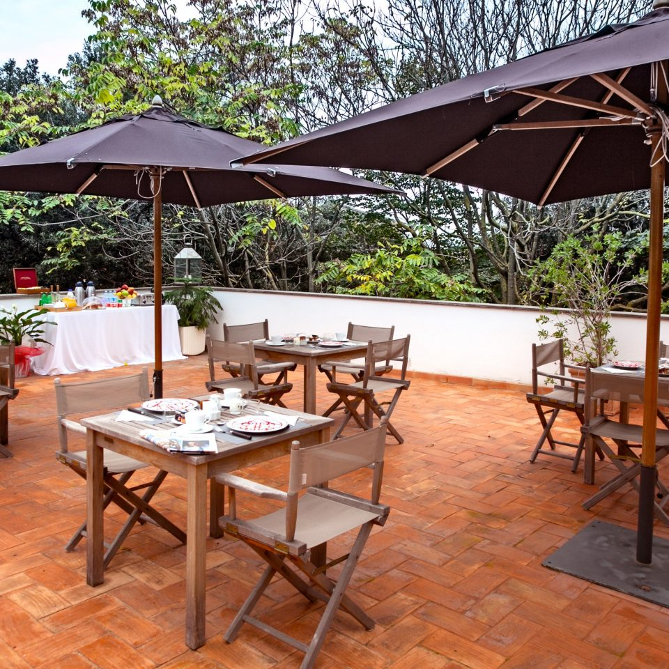 B&B City Dining Eat Historic Rooftop tree chair property restaurant outdoor structure Resort cottage set
