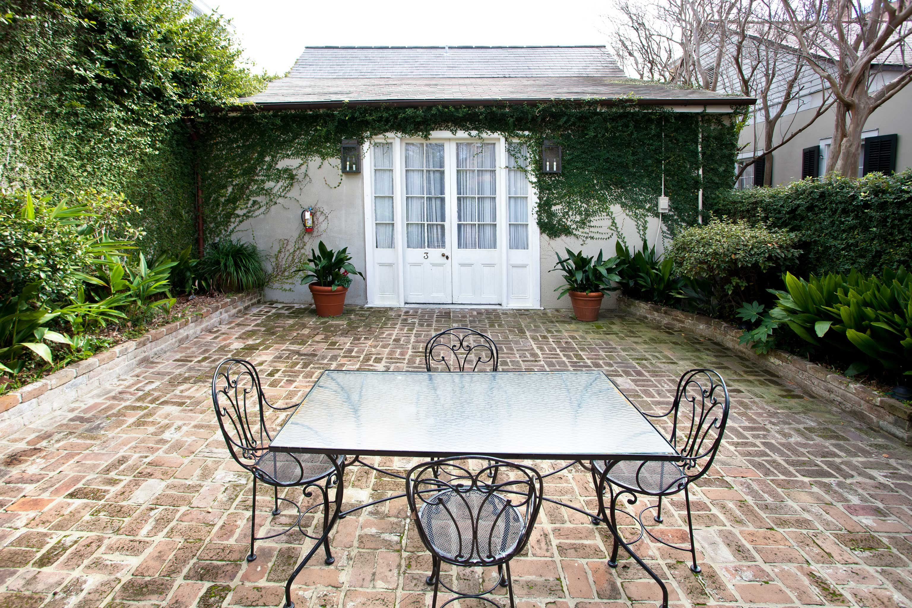 B&B Cultural Drink Eat Entertainment Grounds Nightlife ground tree bench house property park backyard stone yard home Courtyard cottage brick outdoor structure porch Garden Patio Villa farmhouse orangery lawn landscaping handcart empty concrete bushes walkway