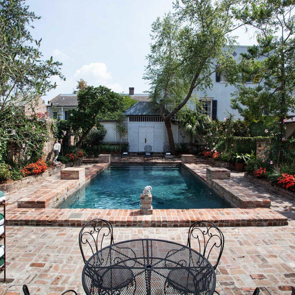 Bb cultural drink eat entertainment nightlife pool tree ground swimming pool property backyard courtyard garden yard