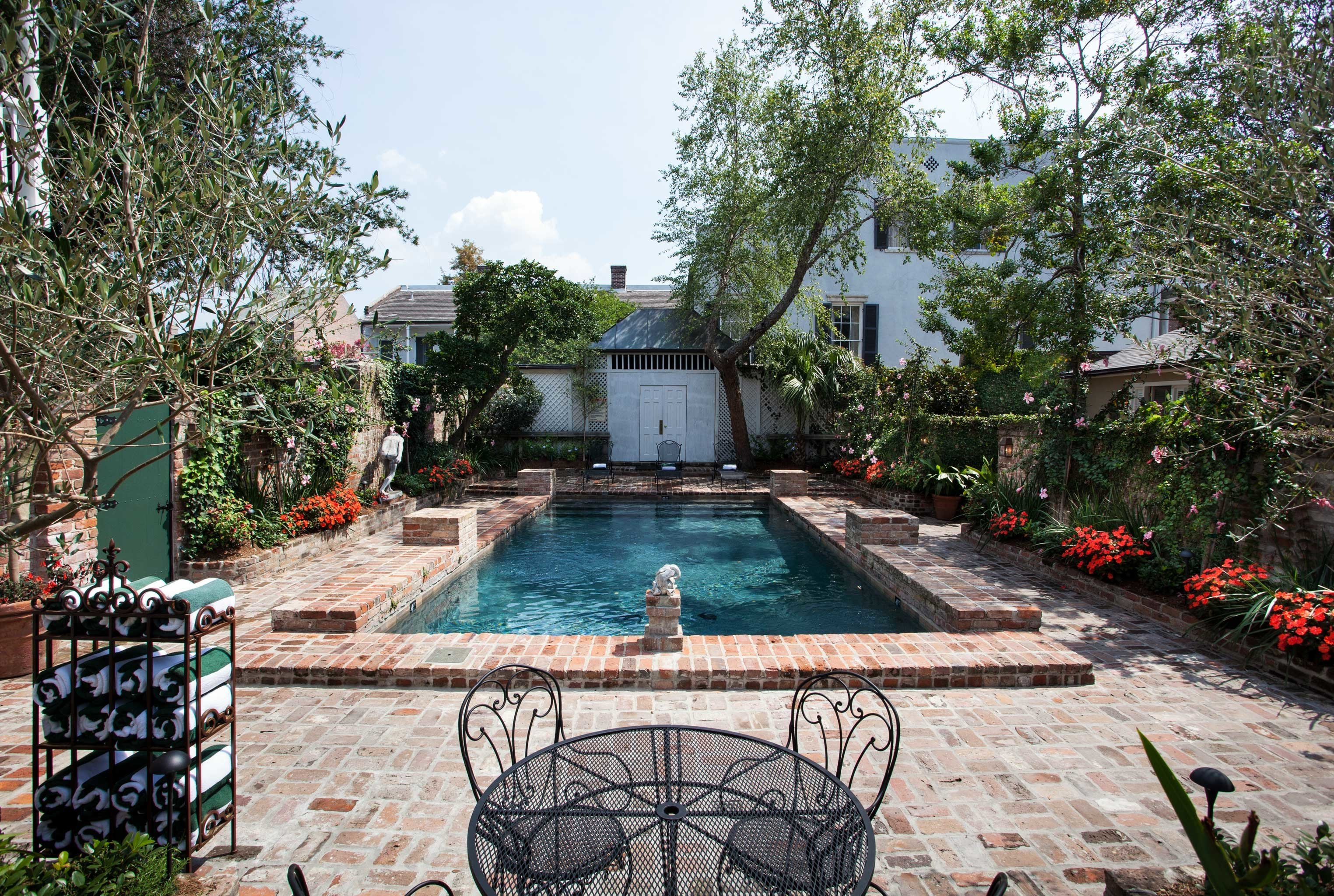B&B Cultural Drink Eat Entertainment Nightlife Pool tree ground swimming pool property backyard Courtyard Garden yard cottage outdoor structure Resort Villa pond stone