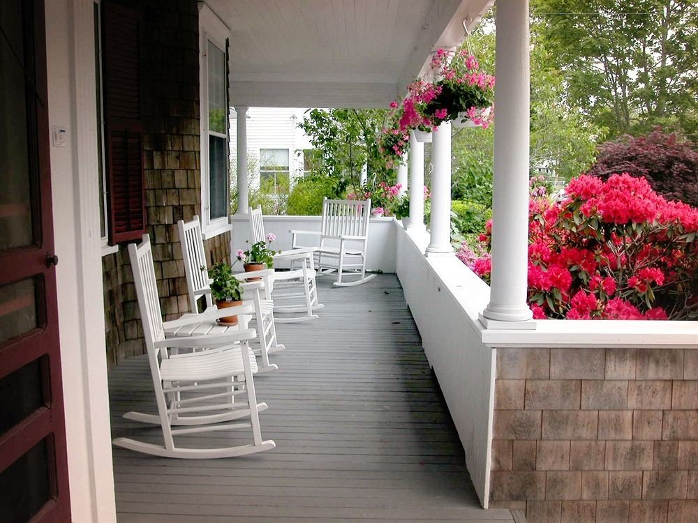 B&B Deck Romantic building porch property home white backyard outdoor structure Courtyard cottage aisle flooring flower Garden