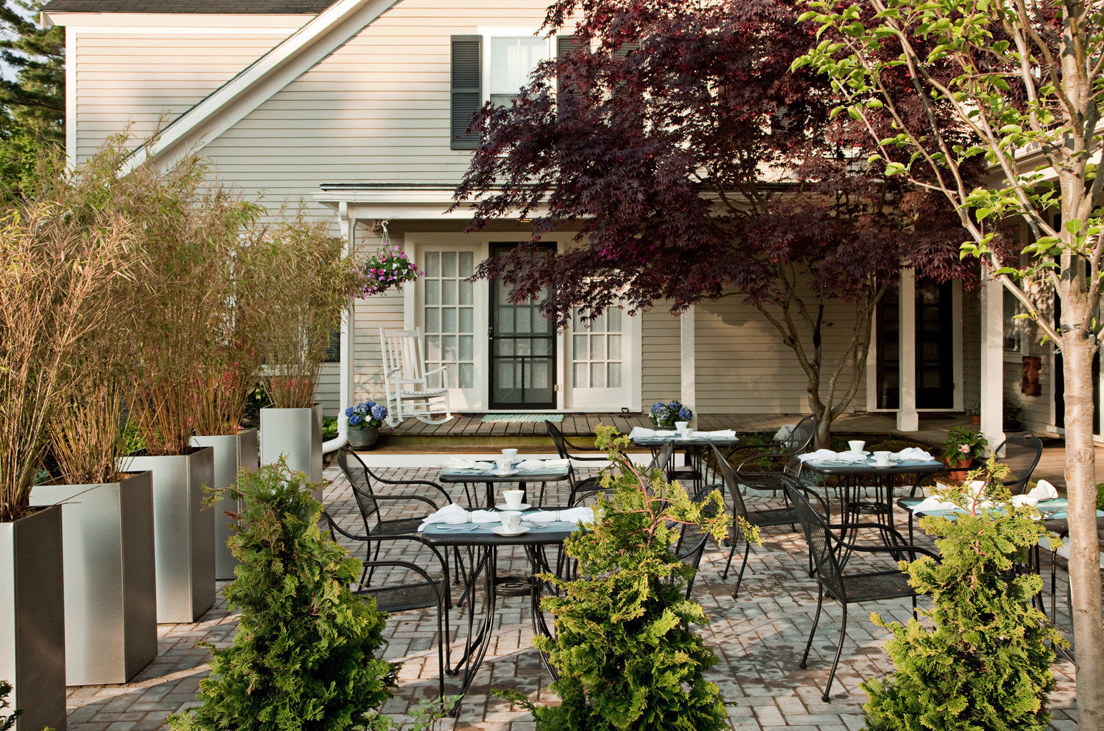 B&B Dining Elegant Grounds Historic Inn tree building house plant property home backyard yard Courtyard porch cottage Garden outdoor structure orangery residential area flower farmhouse lawn landscape architect Patio landscaping Villa bushes stone