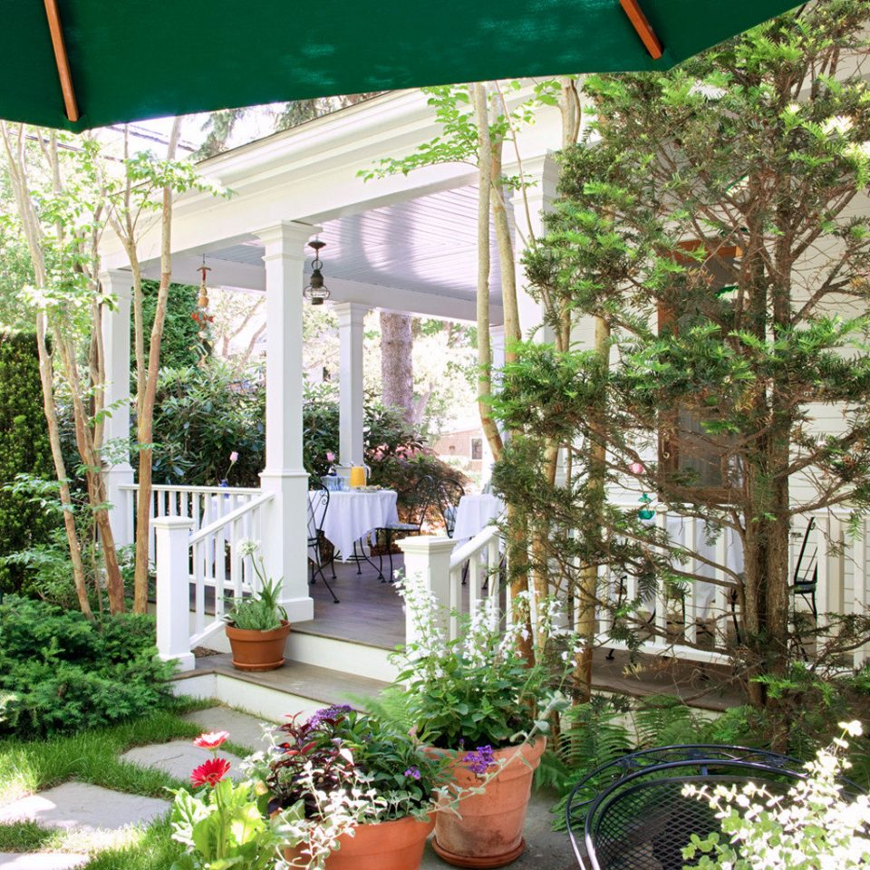 B&B Grounds Ocean tree backyard yard plant Garden floristry porch outdoor structure Courtyard flower home Patio cottage colorful