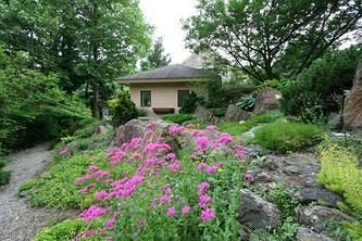 B&B Exterior tree flower plant Garden land plant yard lawn path shrub flowering plant woodland cottage landscaping bushes surrounded stone
