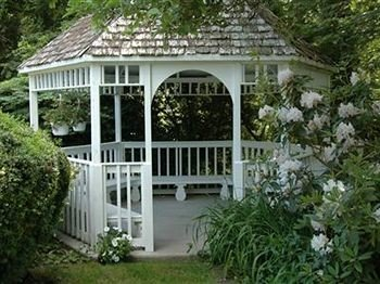 B&B Romantic tree house building gazebo outdoor structure Garden orangery cottage porch pergola greenhouse shed plant bushes stone residential