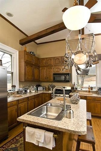 B&B Historic Kitchen property countertop home cabinetry sink stainless counter cuisine classique lighting cottage appliance steel farmhouse Island silver