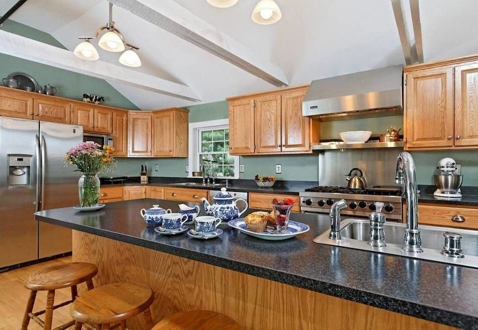 B&B Kitchen cabinet property countertop counter home cabinetry hardwood cuisine classique cottage appliance stainless Island steel